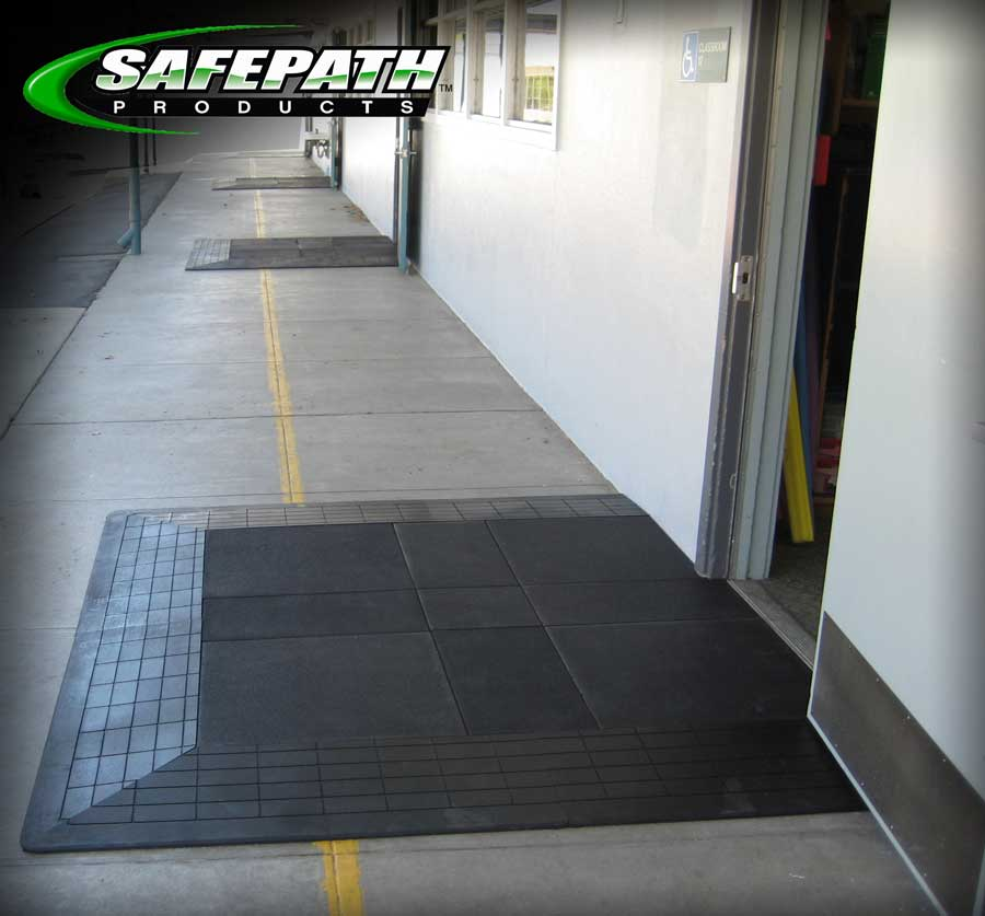 Door entryway threshold ramp and level landing for ADA compliant wheelchair accessibility to school classrooms