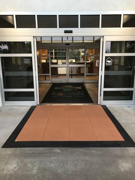 Door entryway threshold ramp and level landing providing ADA compliant wheelchair access